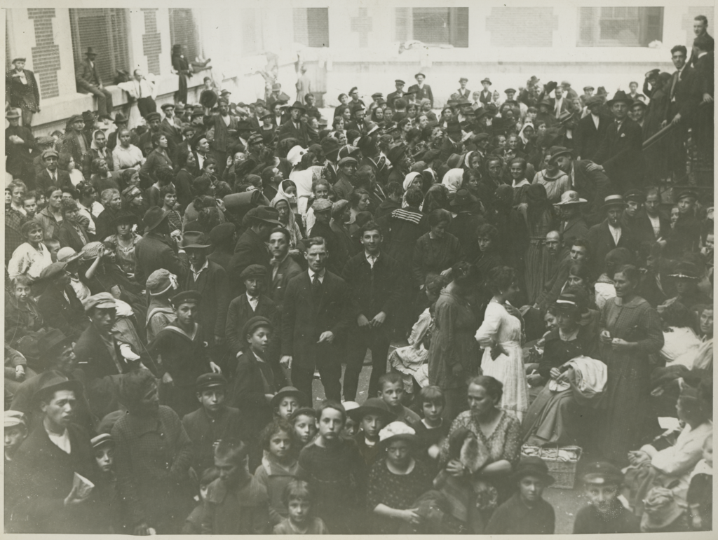 Image of crowd of people from early 20th century